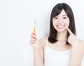 Smiling woman pointing to teeth