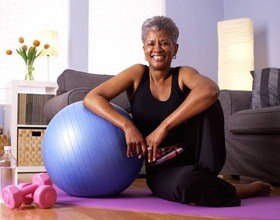 Older woman with exercise equipment