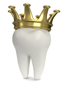 white tooth with gold crown