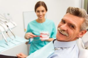 Smiling man getting dental implants in Chesterfield